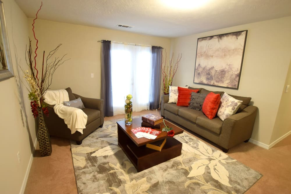 Spacious resident living room at Midsouth 301 in Jackson, Mississippi.