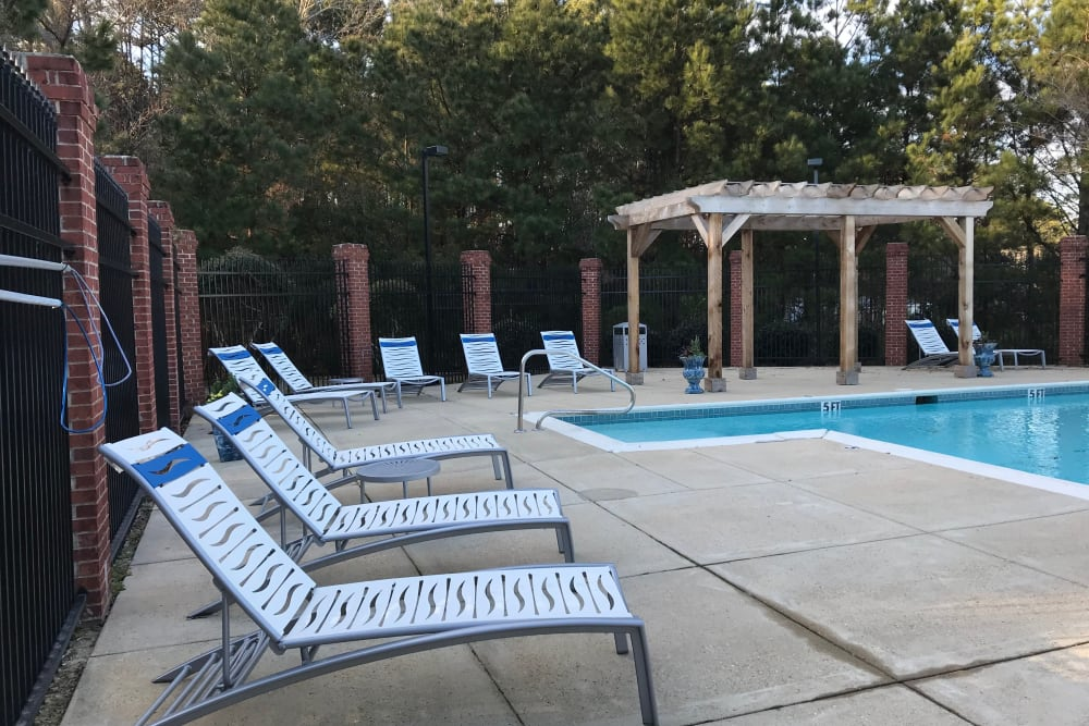 Pool with lounge chairs at Midsouth 301 in Jackson, Mississippi.