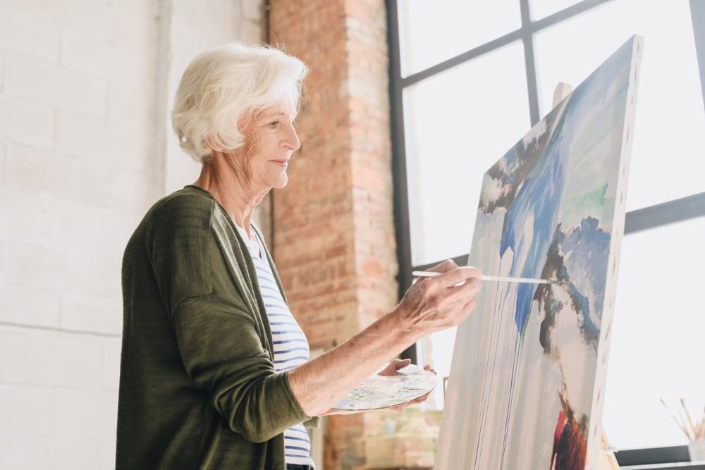 Woman resident painting at Clearwater at Rancharrah in Reno, Nevada