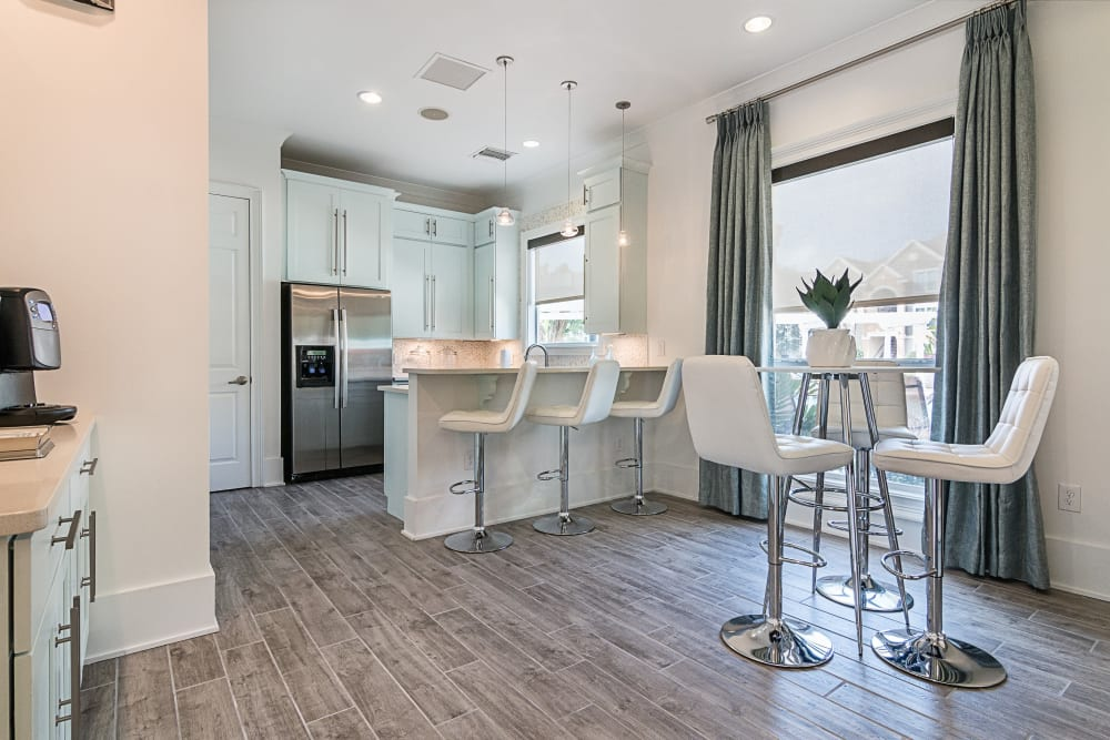 Model kitchen and dining space at Landings at Four Corners in Davenport, Florida