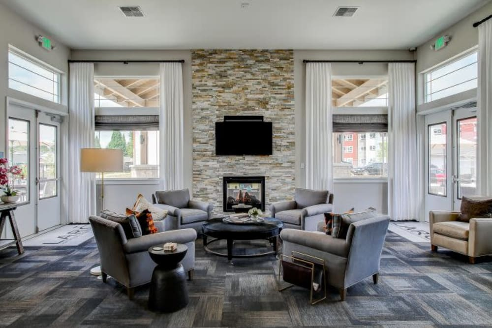 Spacious lounge with comfortable seating, fireplace, and a flat-screen TV at LARC at Kent in Kent, Washington