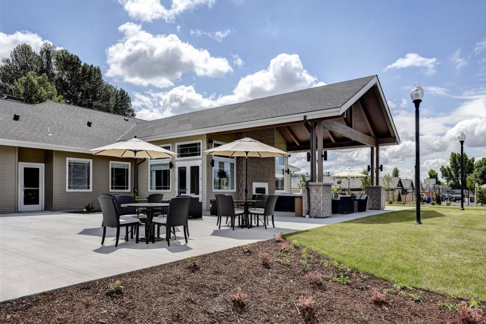 Spacious patio with covered seating at LARC at Kent in Kent, Washington