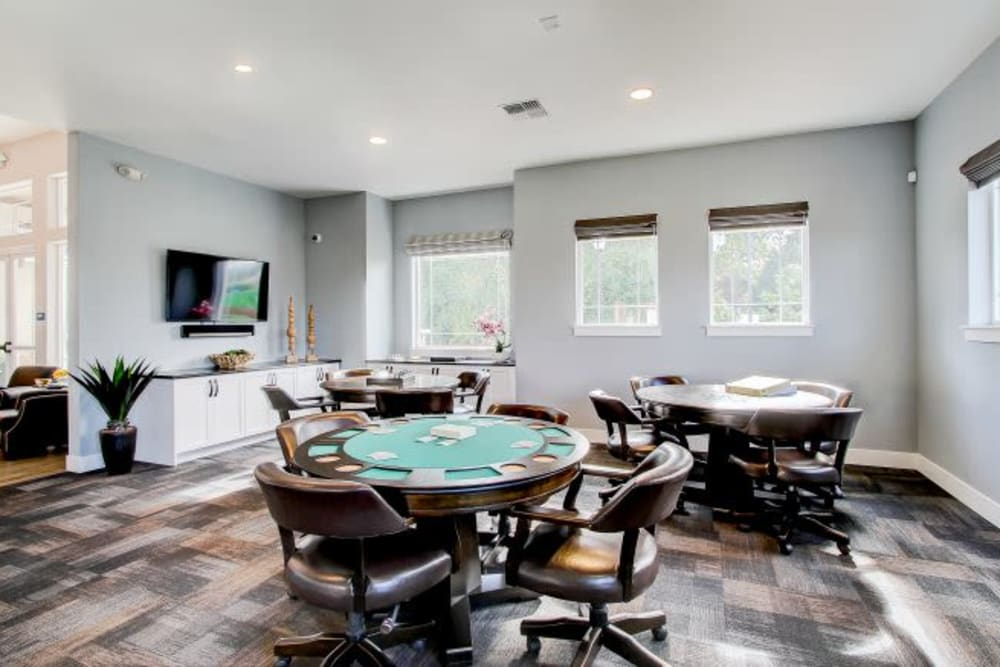 Game room with a large flat-screen TV at LARC at Kent in Kent, Washington