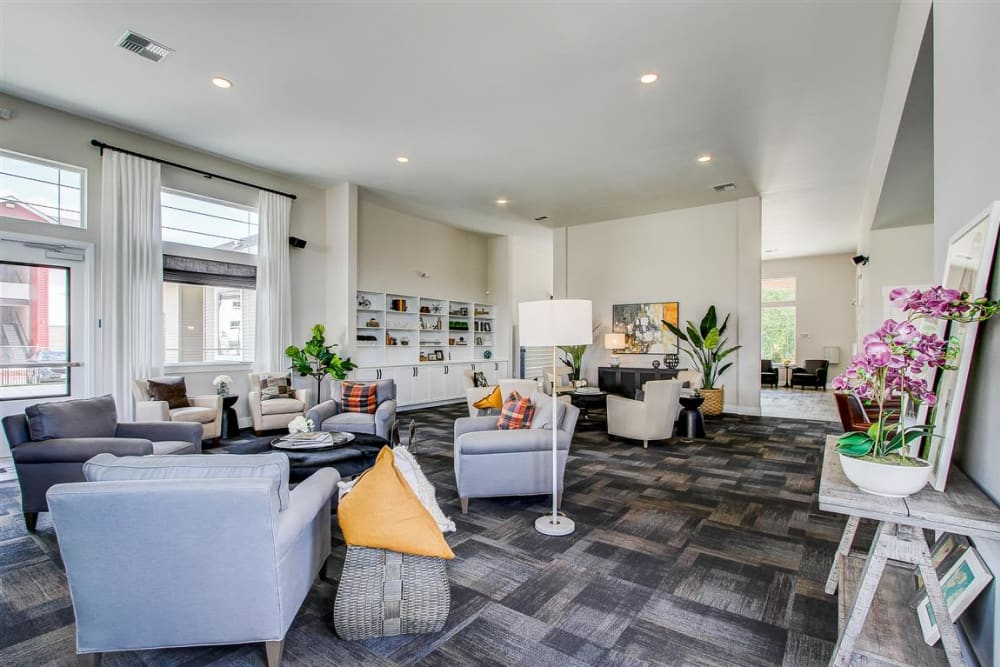 Spacious lounge with plenty of seating for entertaining guests at LARC at Kent in Kent, Washington