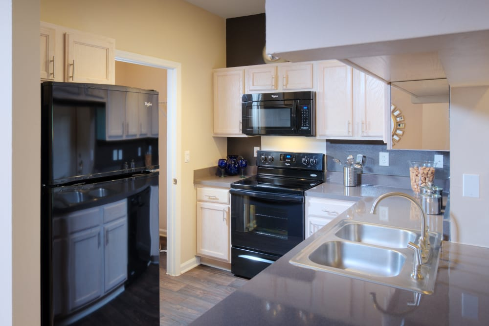 Kitchen with black appliances at Preston View in Morrisville, North Carolina