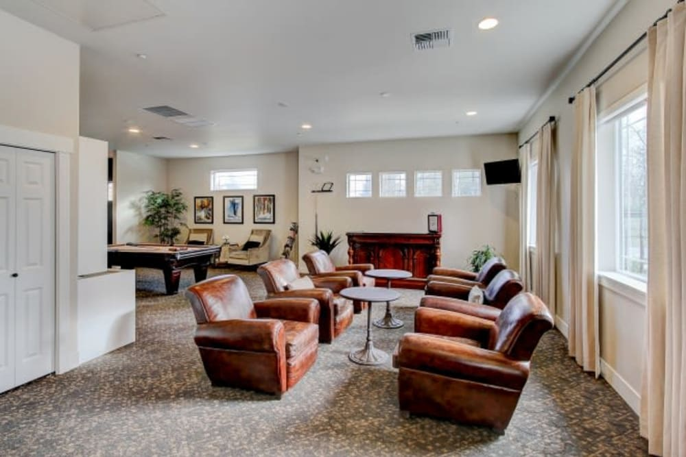 Community clubhouse lounge with plenty of comfortable seating at LARC at Olympia in Olympia, Washington