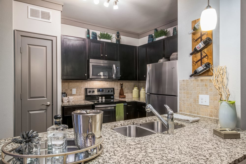 Kitchen with stainless steel appliances at Sorrel Phillips Creek Ranch in Frisco, Texas