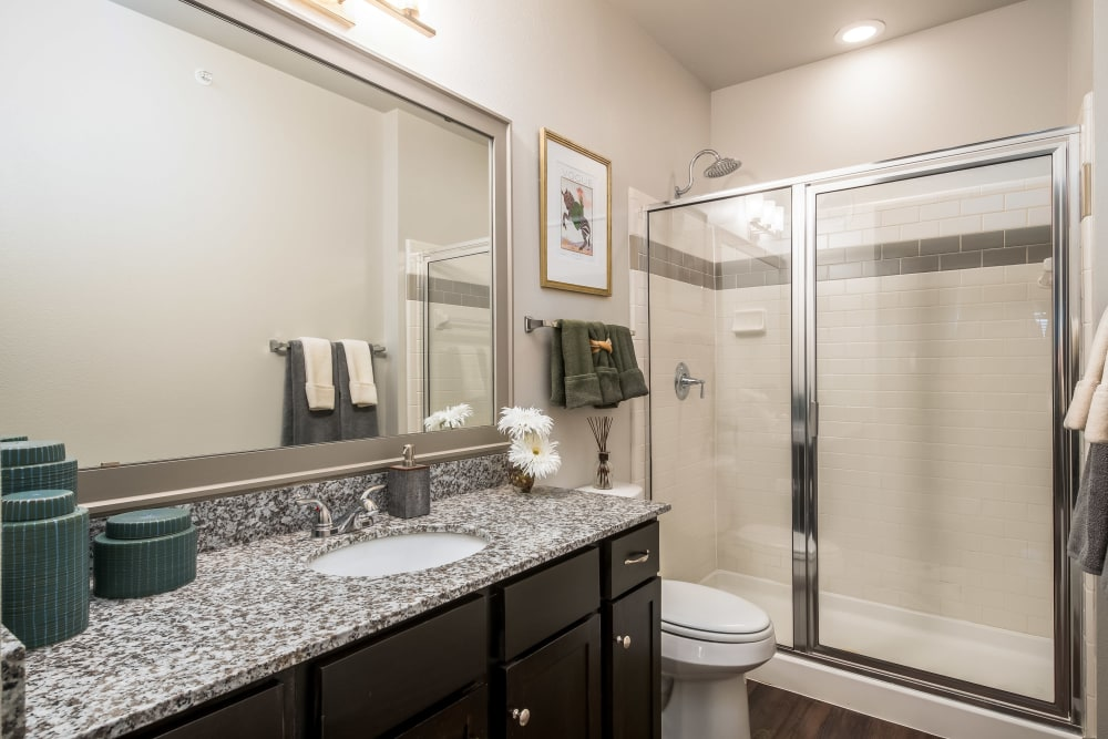 Bathroom with a glass shower door at Sorrel Phillips Creek Ranch in Frisco, Texas