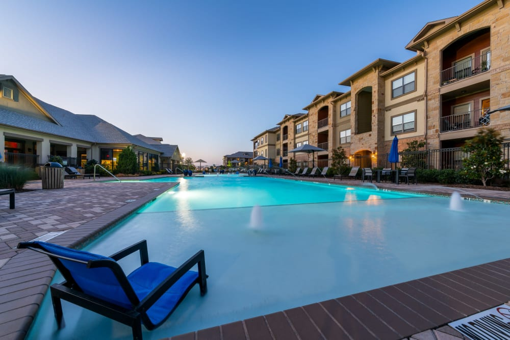 Beautiful pool at twilight at Sorrel Phillips Creek Ranch in Frisco, Texas