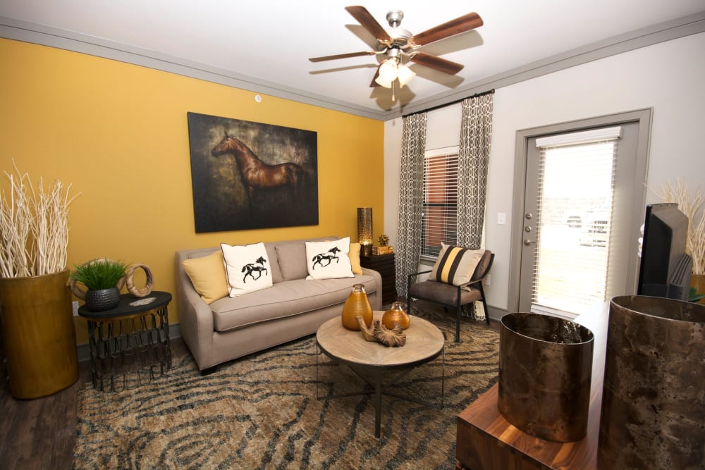Living room with yellow accents at The Sovereign in Fort Worth, Texas
