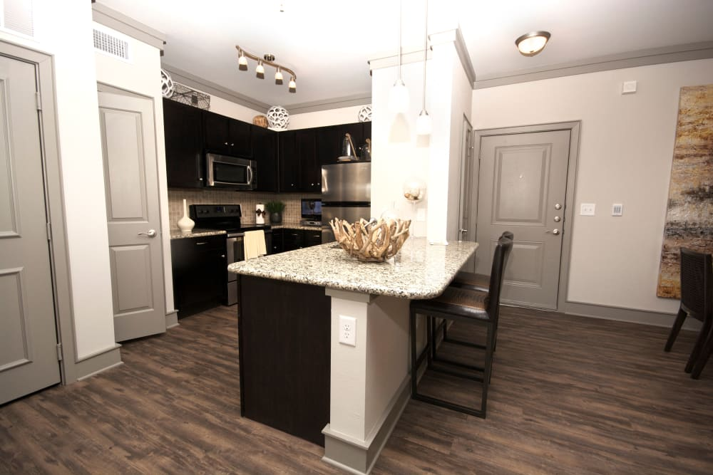 Kitchen with black appliances at The Sovereign in Fort Worth, Texas
