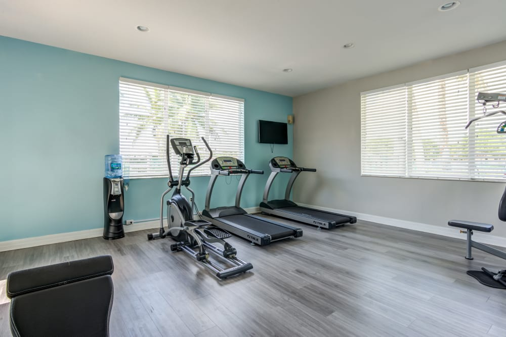 A clean fitness center at Cedar Grove Apartments in Miami Gardens, Florida