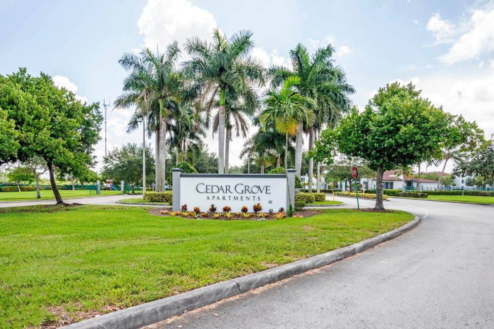 A beautifully manicured landscape at Cedar Grove Apartments in Miami Gardens, Florida