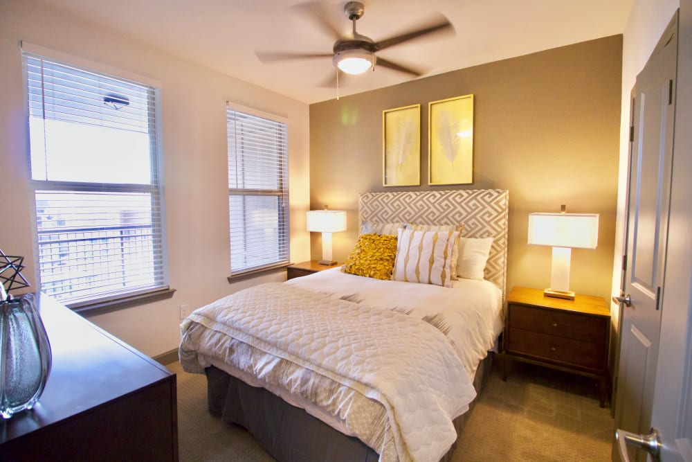 Bedroom with ceiling fan at Watermere at Frisco in Frisco, Texas