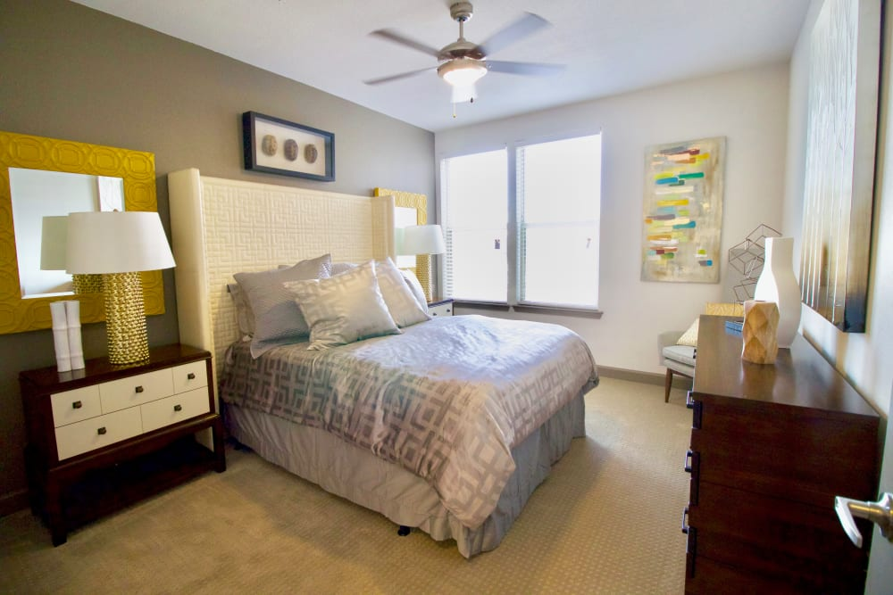 Bedroom with large windows at Watermere at Frisco in Frisco, Texas