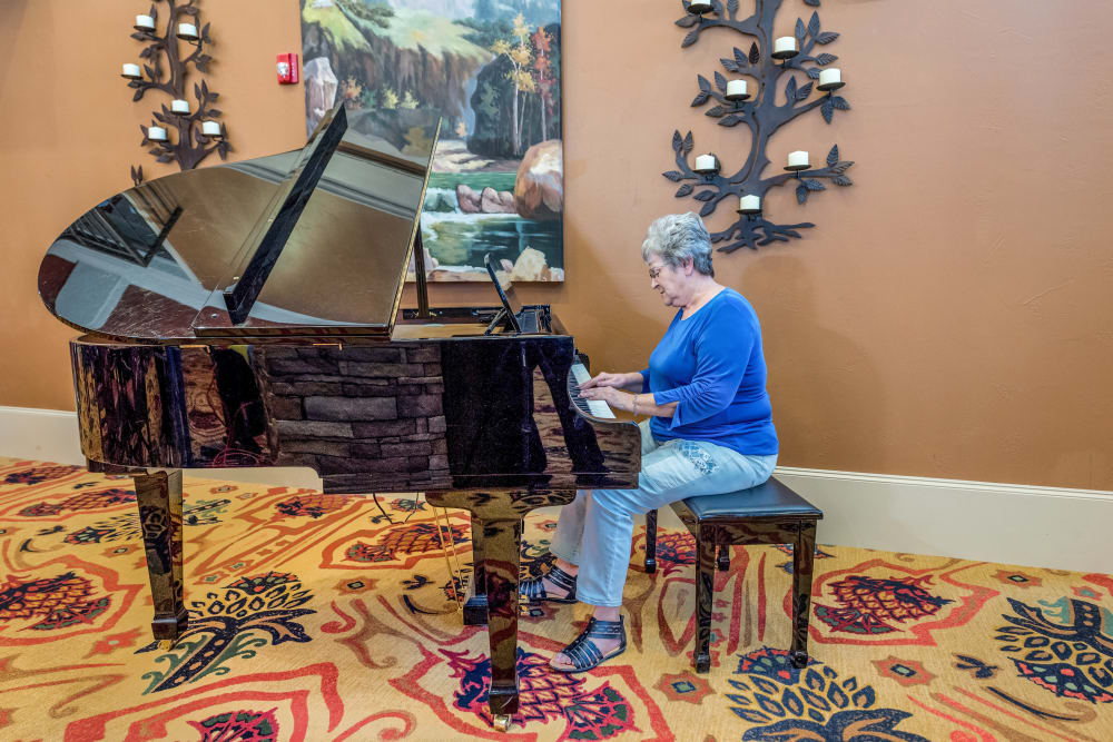 A resident playing the piano at an Integrated Senior Lifestyles community