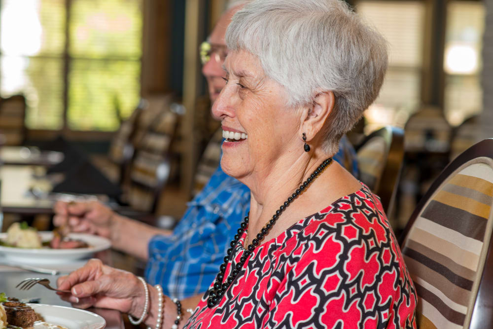 A resident dining at an Integrated Senior Lifestyles community