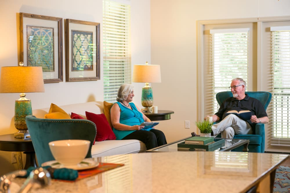 Two residents talking in an apartment at Watermere at Woodland Lakes in Conroe, Texas