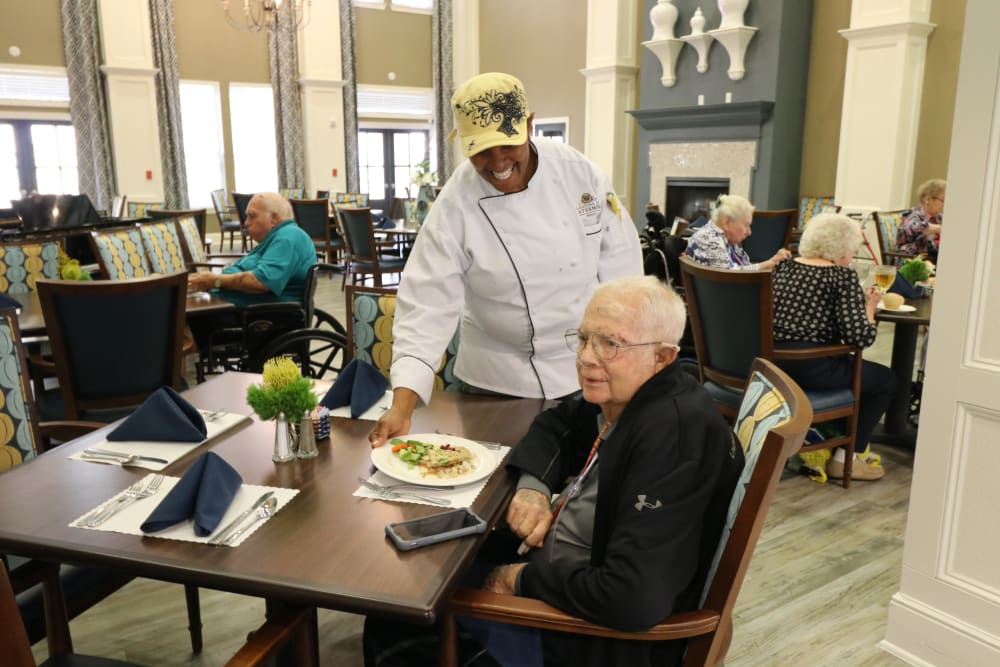 Resident enjoying dinner at Landing at Watermere Frisco in Frisco, Texas