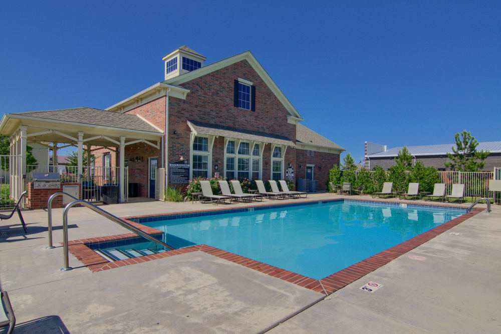 Resident pool with chairs at Traditions at Westmoore in Oklahoma City, Oklahoma.