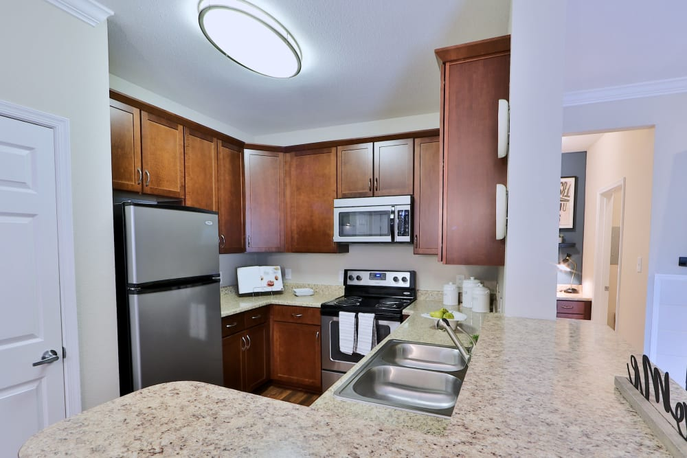 Kitchen at The Village at Potomac Falls Apartment Homes in Sterling, Virginia