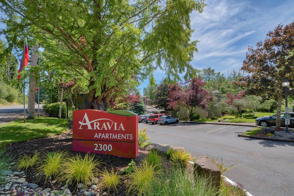 Entrance sign at Aravia Apartments in Tacoma, Washington