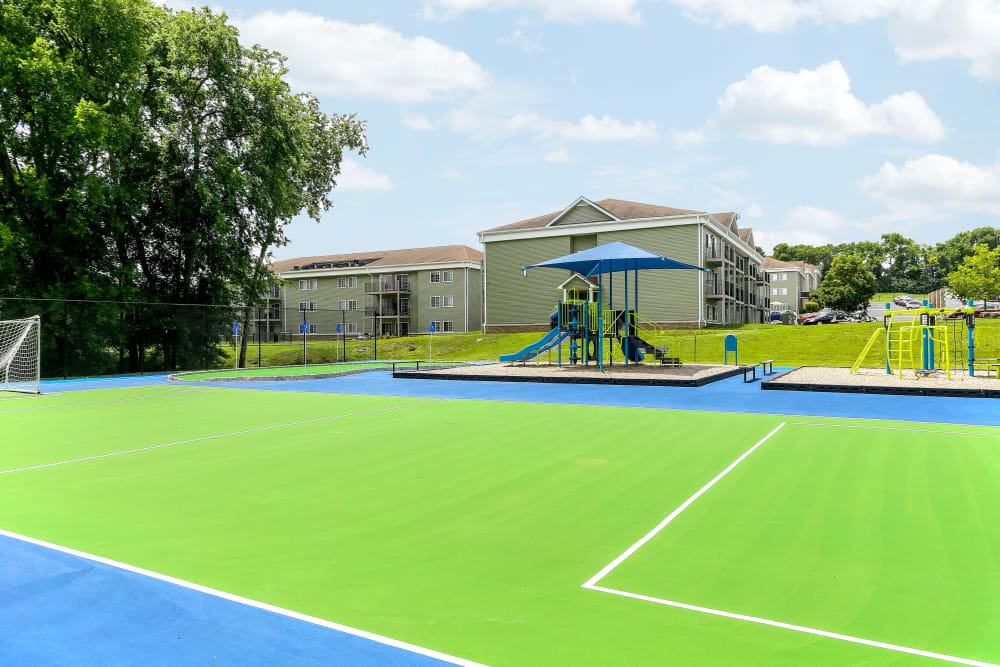 Enjoy Apartments with a Playground & Sport Court Area at Jackson Grove Apartment Homes