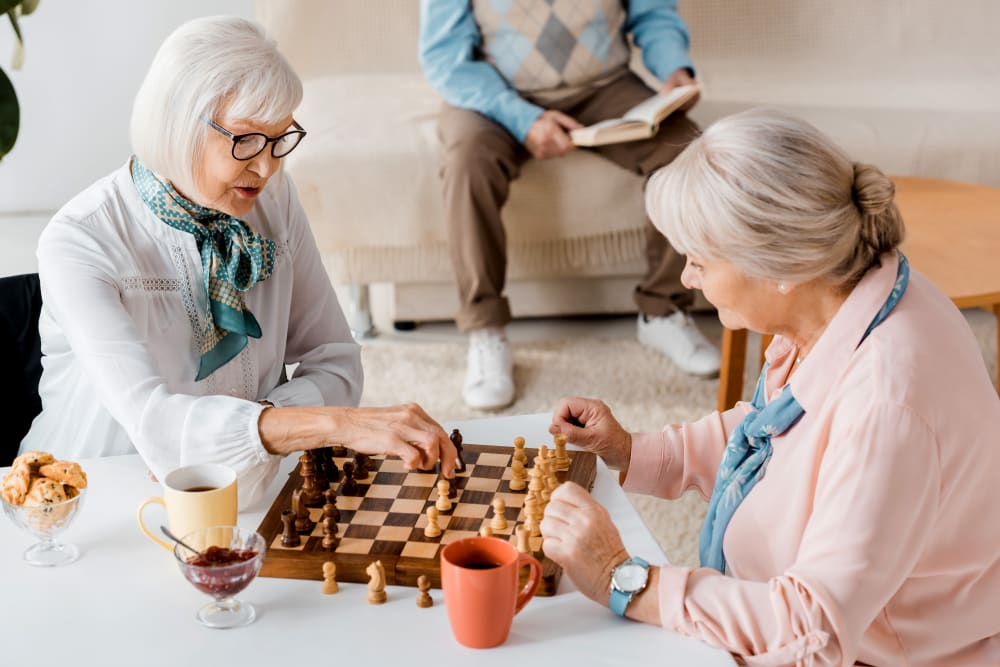 Two residents playing chess at a Keystone community