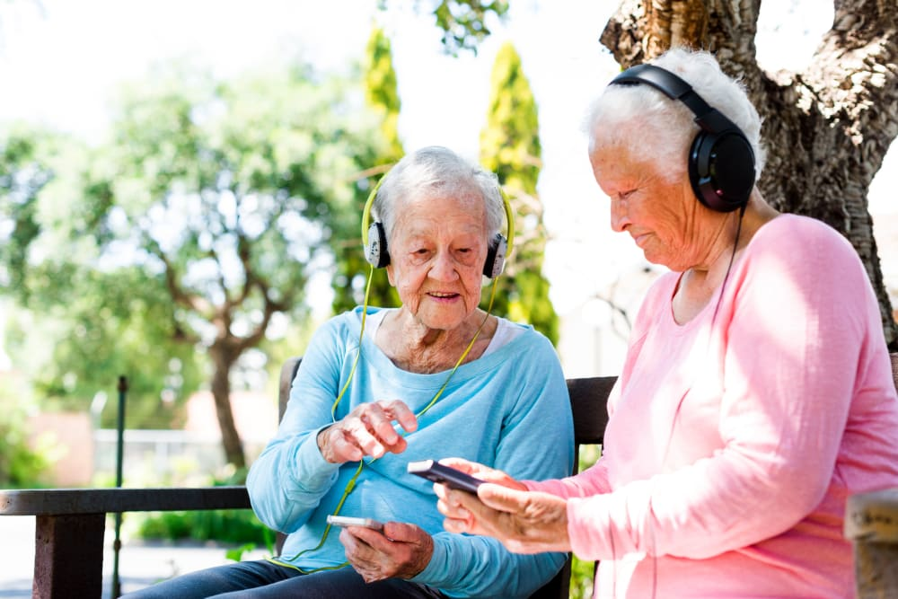 Two residents listening to music outside of a Keystone community