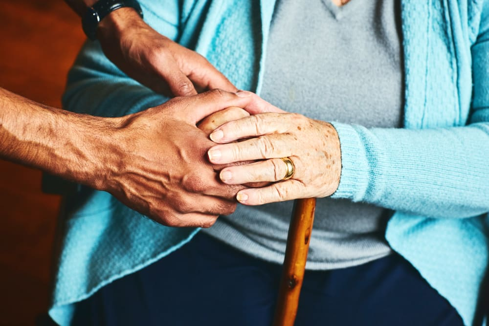 Caretaker holding residents hands at a Keystone community