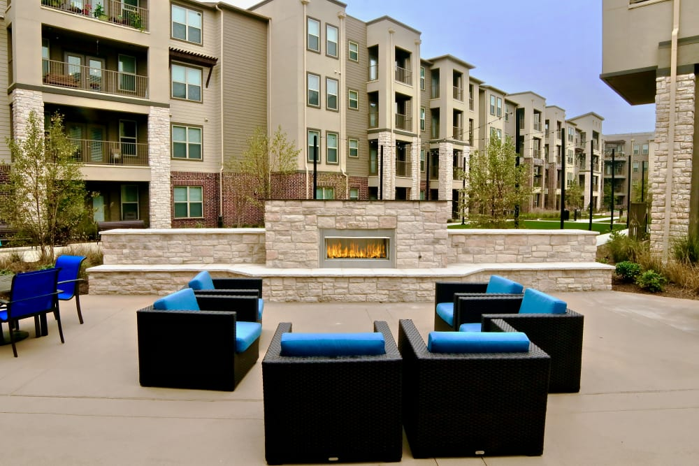 Outdoor seating and fire fit at an Integrated Senior Lifestyles community
