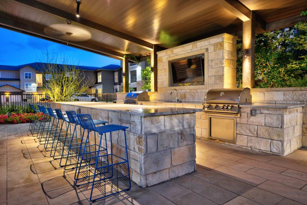 Enjoy the outdoor BBQ area at Alta Tech Ridge in Austin, Texas