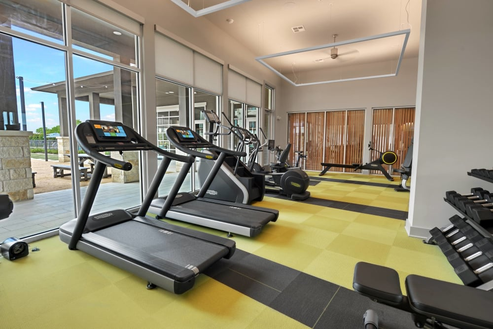Workout in the fitness center at Alta Tech Ridge in Austin, Texas