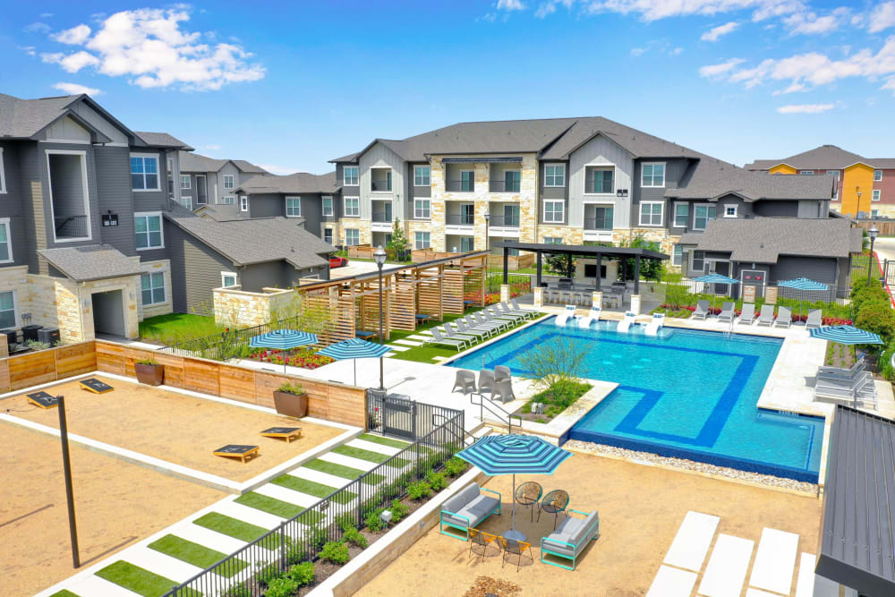 Exterior shot of pool and apartments at Alta Tech Ridge in Austin, Texas