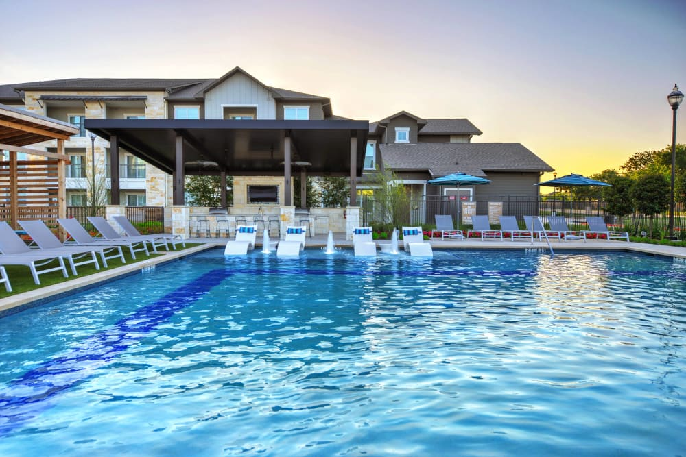 Outdoor swimming pool available at Alta Tech Ridge in Austin, Texas