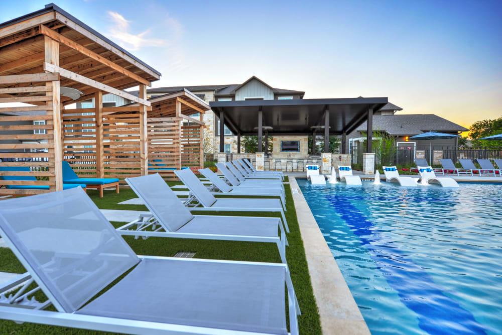Enjoy seating by the pool at Alta Tech Ridge in Austin, Texas