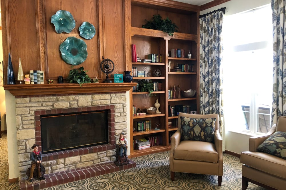 Lounge with fireplace and a big window at Creekside Village in Ponca City, Oklahoma.
