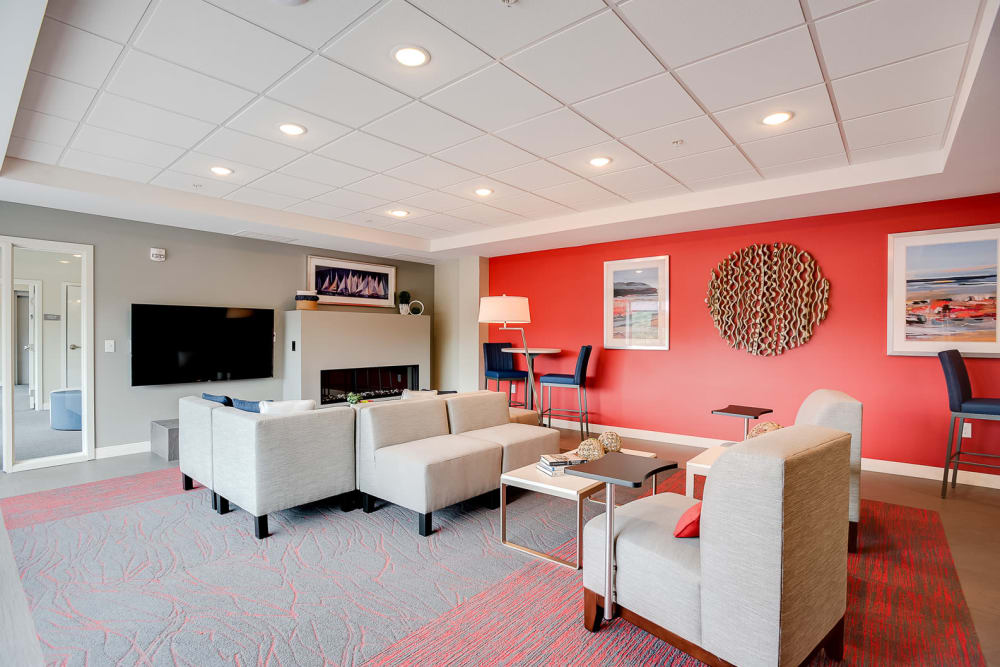A spacious clubhouse with a flat-screen TV for watching sports at Lake Jonathan Flats in Chaska, Minnesota