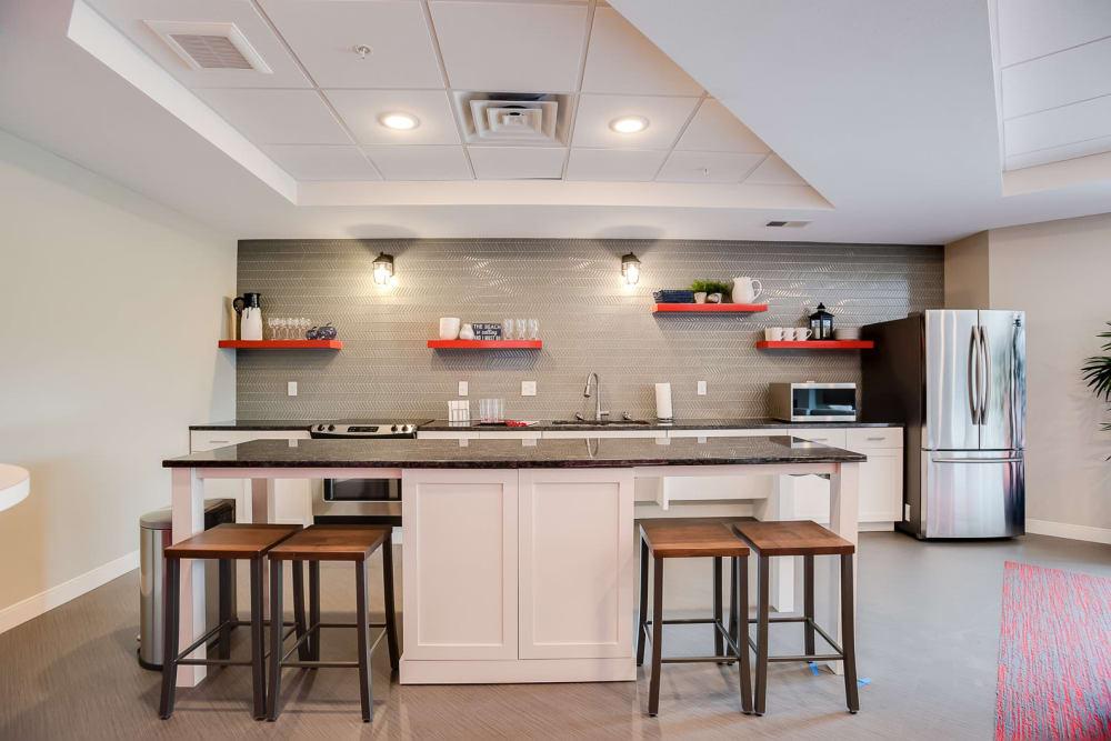 A community kitchen with a fridge at Lake Jonathan Flats in Chaska, Minnesota