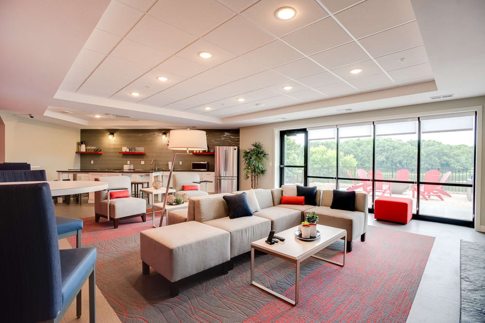 A large clubhouse with comfortable seating and a view of the river at Lake Jonathan Flats in Chaska, Minnesota