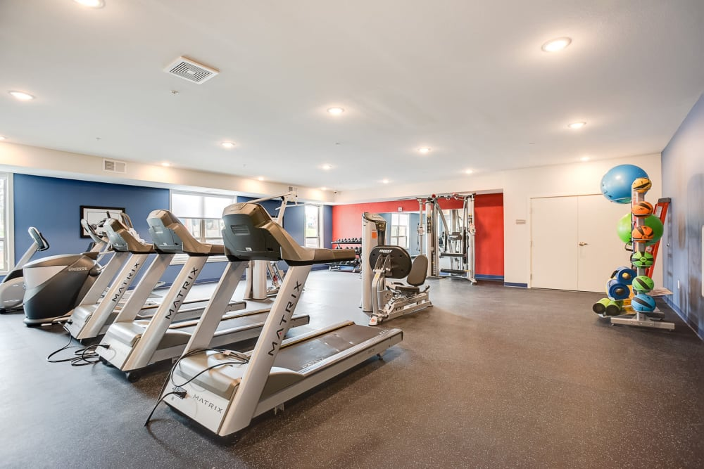 A spacious fitness center with individual workout stations at Lake Jonathan Flats in Chaska, Minnesota