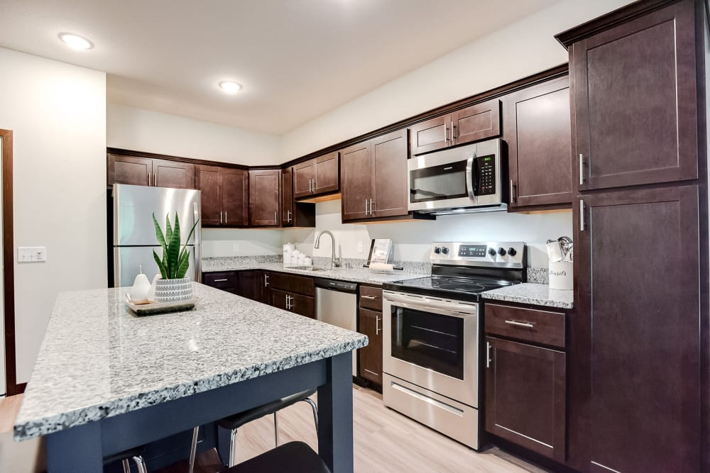 A spacious kitchen with stainless-steel appliances at Lake Jonathan Flats in Chaska, Minnesota