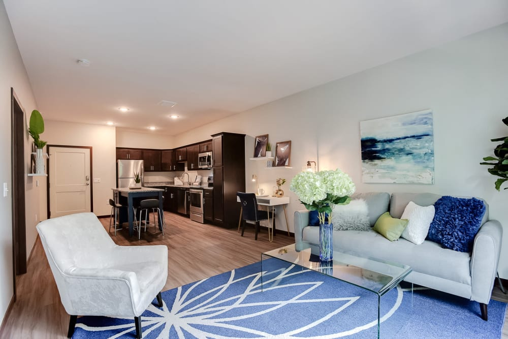 An open concept layout with plenty of space for entertaining guests at Lake Jonathan Flats in Chaska, Minnesota