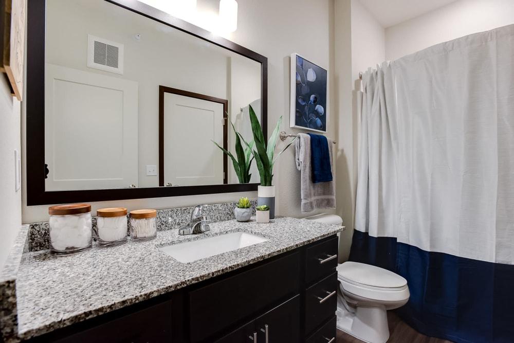 A luxury bathroom with granite countertops at Lake Jonathan Flats in Chaska, Minnesota