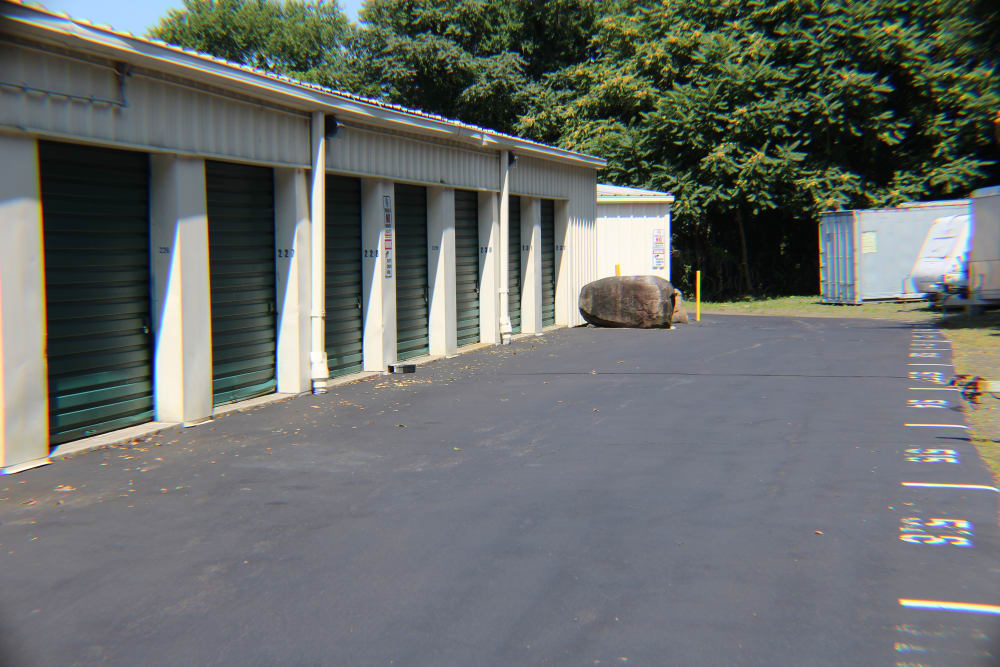 Wide driveways in front of outdoor storage units at Global Self Storage in Clinton, Connecticut