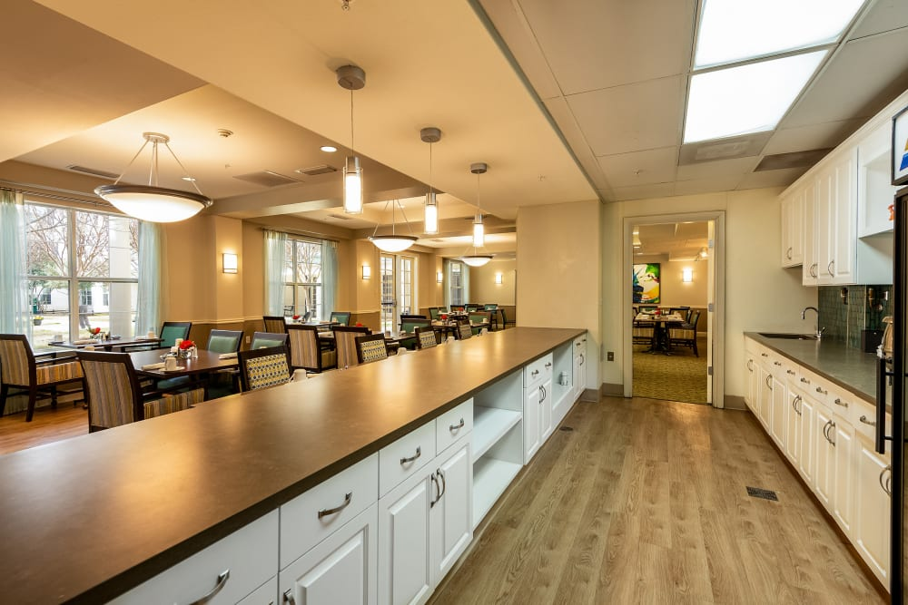 kitchen with bar at Prestonwood Court in Plano, Texas