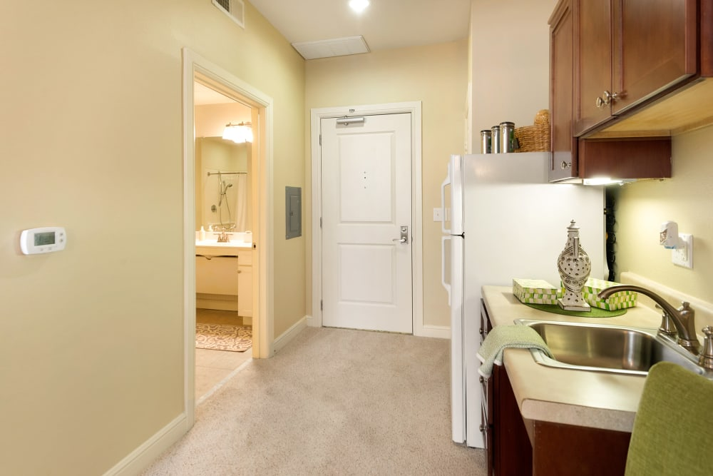 kitchen in a living space at Prestonwood Court in Plano, Texas
