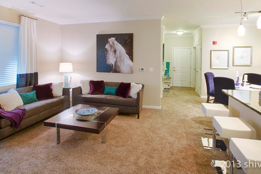 Living room and dining space at Greyson on 27 in Nicholasville, Kentucky