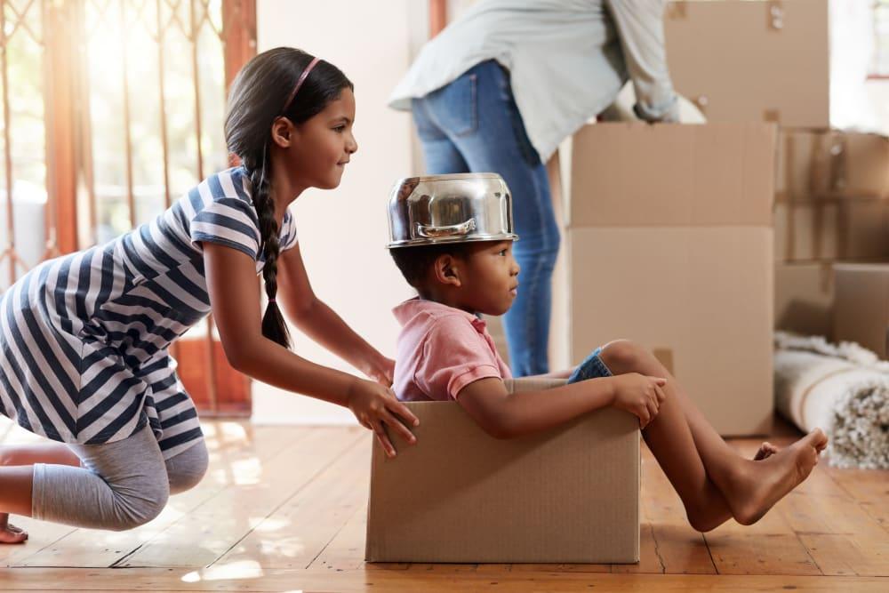 A children having fun moving near Castro Valley Storage LLC in Castro Valley, California
