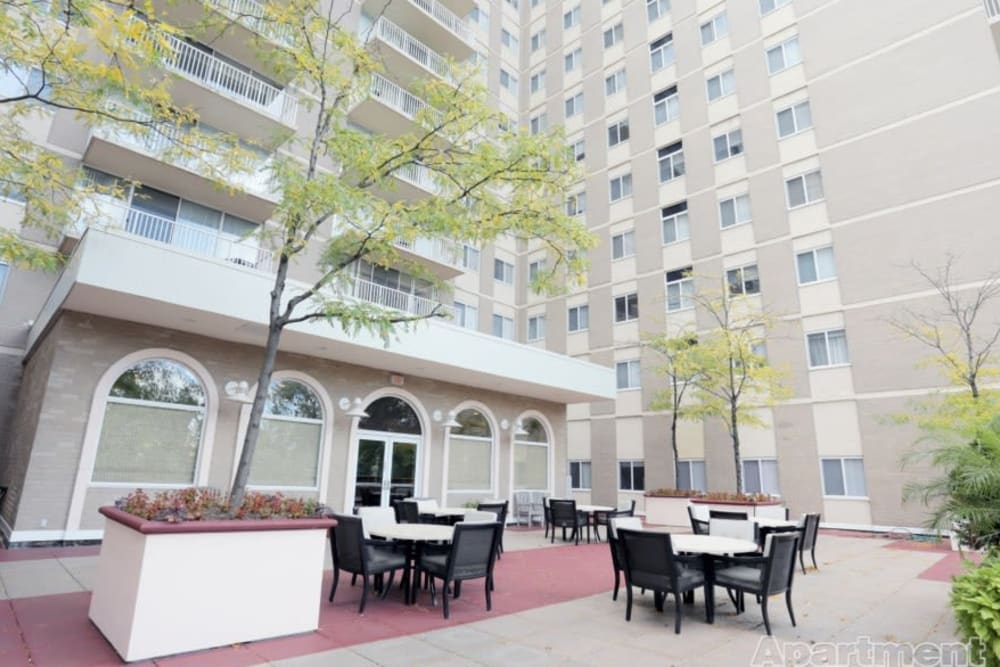 Ground flooring patio with tables and chairs at Westwood Tower Apartments in Bethesda, Maryland